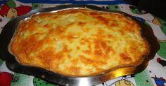 1 couve - flor média  - 3 ovos (claras e gemas separadas)  - 50 g de queijo parmesão ralado  - 500 ml de leite  - 1 colher (sopa) de manteiga  - 2 colheres (sopa) rasas de farinha de trigo  - Sal a gosto  -