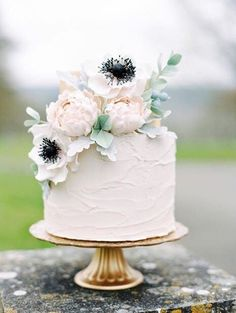Simple and stunning wedding cake topped with flowers