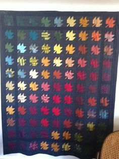Maple Leaf Tie Quilt that my mother-in-law made.  It's hanging in my living room and I love it.