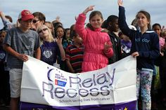 "Students perform ""We Are the World,"" singing and using American Sign Language, May 8 at Stetson Elementary School in Falcon School District 49. Afterward, more than 600 preschool-fifth grade students from the school walked around a neighboring park, as part of their school's second annual Relay Recess. Ahead of the event, they raised money for the American Cancer Society. The American Cancer Society's Relay Recess provides elementary schools an abbreviated version of its Relay For Life."