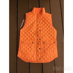 J.Crew Shiny Quilted Field Puffer Vest Orange Gorgeous vest! In a brilliant orange color • Sold out on J.Crew website❗️No flaws at all, worn once max • Size XS but can fit a small as well • All photos in this listing are mine and were taken by me in daylight • NO TRADES. NO PAYPAL • J. Crew Jackets & Coats Vests