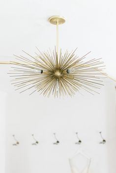 Sputnik style chandelier in the perfect gold hue | Design by Manderley Design Co. -  http://www.manderleydesignco.com/ | Photography: Matthew Land Studios - http://www.matthewland.com/