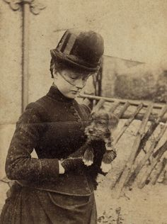 English Victorian lady with a puppy, ca. 1900