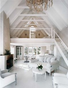 I want a beach cottage in Oregon that looks just like this. Maybe more primitive:) Id love 10 bunk beds for kids and 2 rooms on the main level. I want a great kitchen, not necessarily large and an open living area just like this! Open Living Area, Small Living, A Frame Cabin, Beach Cottage Style, Cottage Chic, Lake Cottage, White Cottage, Cottage Ideas, Tiny House Design