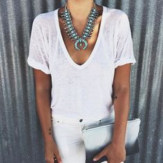 Turquoise Squash Blossom necklace. Looks incredible against her tanned skin and all-white outfit.