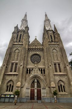 magnificent view of the cathedral exploring the spires as well as the beautiful front facade. Pink Mosque, Jakarta City, Stage Photo, Building Drawing, Dutch Colonial, Cathedral Church, Art And Architecture, Barcelona Cathedral, Catholic