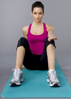 BYE BYE TO YOUR INNER THIGHS: Sit on the floor with your back straight, knees bent and legs wide apart.   Place your left arm directly over your left knee, using your right hand to support yourself by your hip (pictured left). While sitting straight, move your right foot to your left hand and hold for five seconds to start. Begin with five reps, then repeat on the other side