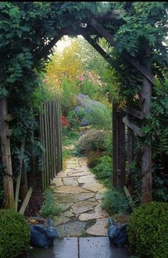 I think I shall walk beneath that arbor, meander along the path and find a place to sit and mull over my secrets... in this garden.