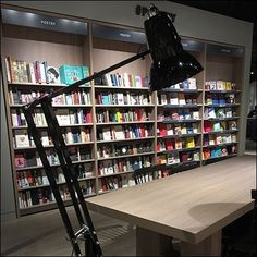 Set the mood and reinforce branding with decor like this Giant Desk Lamp as Bookstore Floor Lamp.