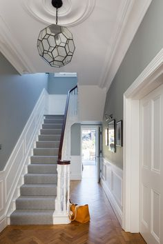 Oak Parquet Flooring White Panelling And Patterned Runner On The Staircase In Entrance Hallway