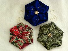 Folded fabric quilted Christmas ornaments tutorials complete with photos are free. Folded Fabric Ornaments, Quilted Christmas Ornaments, Christmas Sewing, Christmas Fabric, Handmade Ornaments, Handmade Christmas, Christmas Crafts, Christmas Decorations, Christmas Quilting
