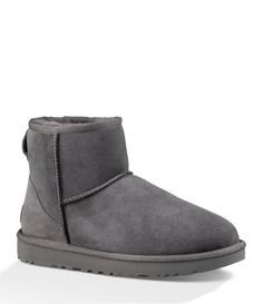 """From UGG®, the Classic Mini II booties feature:real bleached and dyed lamb fur (Australia, UK, or USA)17 mm Twinface upper, pre-treated to repel moisture and stainssuede heel counterOverlock stitch detail on seamsnylon bindingleather heel logo labelpull-on stylingrear pull tabshearling lining17 mm sheepskin insoleTreadlite by UGG outsoleApprox. 5.5"""" shaft heightImported. #AustralianSheepskinBoots"""