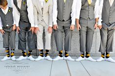 Don't just match the ushers ties, buy them matching socks. It makes for fantastic pictures