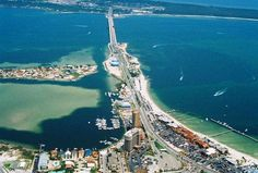 """Pensacola, Florida in northwest FL in the panhandle acquired the nickname """"The Emerald Coast"""" in the county of Escambia cities around are  Goulding, FL (1.1 miles ), West Pensacola, FL (1.8 miles ), Brent, FL (1.8 miles ), Ferry Pass, FL (2.3 miles ), Gulf Breeze, FL (2.4 miles ), Myrtle Grove, FL (2.4 miles ), Bellview, FL (2.4 miles ), Warrington, FL (2.4 miles )."""