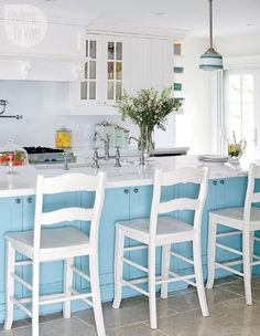 A pretty blue kitchen island always makes my heart skip a beat; throw some pink in the mix and I'm a total goner! Stacy McLennan Interiors used my favorite color combo throughout this 1950s Toronto bu