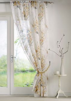 This cherry blossom printed voile will add a fresh and brightness to your home, even if the sun is not shining! A simple plain voile with delicate feminine print in bold yellow colours, with a slot top heading!