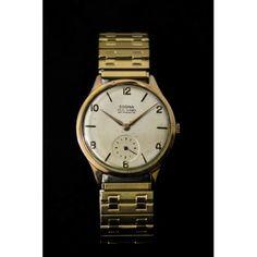 471824238ae Clásico reloj de pulsera en oro de 18 k de la marca de Dogma