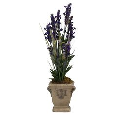Silk purple and white mountain lavender in a footed stone planter.  Product: Faux floral arrangementConstruction Mat...