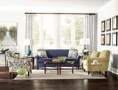 "Style Collection: Josie Sofa features a crisp, tight back and slim rolled arms for an 82"" long sofa. A deep blue fabric for the body is accented by a bold and fun floral of blues, greens and greys."