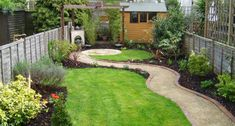 A design incorporating curves and circles disguises the rectangular shape of the garden and the sinuous hoggin path leads the eye across the space, making it appear much wider.
