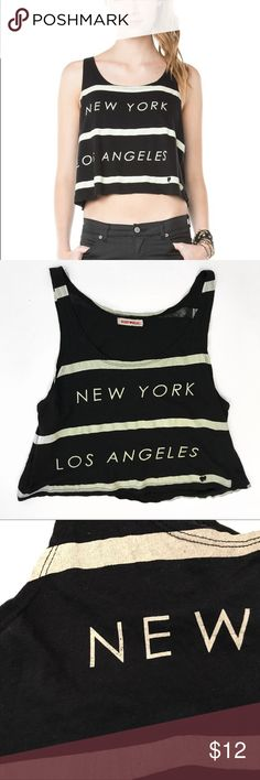 Brandy❤️Melville • New York Los Angeles Tank Brandy❤️Melville • New York Los Angeles Tank. Comes from smoke and pet free home. Brandy Melville Tops Tank Tops