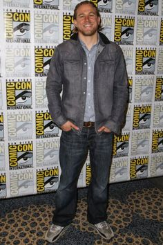 Charlie Hunnam: Hunnam stopped by Comic Con in gray and navy New Balance sneakers.