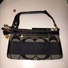 Authentic Coach Small Purse Authentic Coach Wristlet pre-owned condition but in like new condition. Black and grayish color. Coach Bags Mini Bags