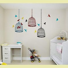 I love the idea of having a nursery that is little bird themed!! And I LOVE the colored bird cage stencils on the wall!!
