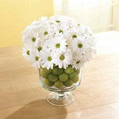 Instead of rocks, try fulling our Trifle Bowl with limes before adding flowers.