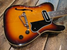 A custom made Tele thinline with an archtop style pickguard and stoptail and a very jazzy archtop kind of pups configuration: just one, in the neck, and it's a Charlie Christian Pickup. Jazz Guitar, Music Guitar, Guitar Amp, Cool Guitar, Rare Guitars, Fender Guitars, Vintage Guitars, Telecaster Thinline, Archtop Guitar