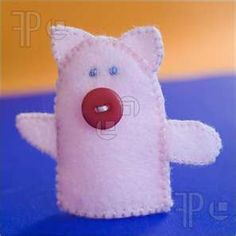 Finger Puppet. use 4 hole button with slots vertical, will look more like a snout.