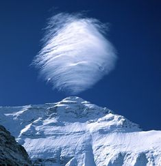 Mount Everest is so tall that it interferes with the clouds that pass by. Here a lenticular cloud forms above its peak.