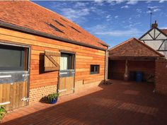 Home Grown Feather Edge Larch and its CODE LEVEL 6 COMPLIANT www.co2timber.co.uk