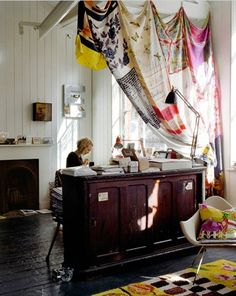 Many uses for draperies --loft divider