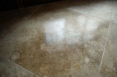 Cleaning Travertine tiles SAFE: Water, Granite and/or Natural Stone specific products, Water and rubbing alcohol mix 16:1 (a.k.a. 1 quart water to 1/4 cup rubbing alcohol)