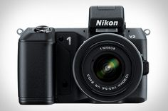When Nikons first 1 series cameras launched, they looked nice enough, but there also wasnt a ton of differentiation between them. That ends with the Nikon 1 V2 Camera $900. Sporting a completely redesigned body, the V2 features a 14.2-megapixel sensor, an ergonomic grip, a new Command Mode Dial, a built-in flash, up to 15 fps still shooting thanks to the new Expeed 3A image processing engine, and 1080p video recording. Just remember: its what the results look like, not the camera that took…