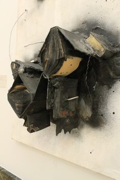 "John Latham ""Belief System"" 1959 (Books, Plaster, Metal, Light Bulb, and Paint on Canvas)."