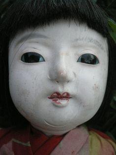 Ichimatsu doll  gofun head,arms, 1/2 legs  head has wooden spike which goes through her body.seen on ebay auction  around 1930's