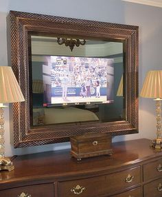 TV Hidden Behind Two Way Mirror