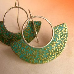 I am in love with these!! Floral Verdigris Earrings Brass And Sterling Silver by Mocahete, $46.00