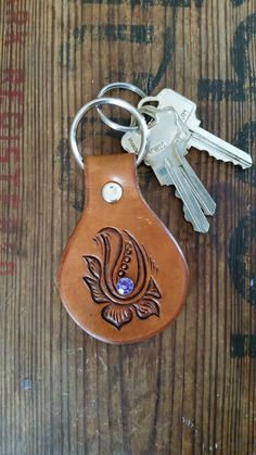 Check out this item in my Etsy shop https://www.etsy.com/listing/453715890/hand-carved-leather-keychain-floral
