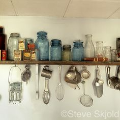 vintage utensils and blue glass jars