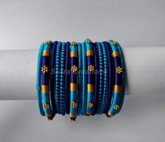 Excited to share the latest addition to my shop: Silk Thread Bangles * Set of 16 Bangles * Sky Blue and Navy Blue Silk Thread Bangles Design, Silk Bangles, Silk Thread Earrings, Bridal Bangles, Thread Jewellery, Fabric Jewelry, Silver Bracelets, Bridal Jewellery, Bangle Set