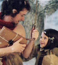 """A merry scene showing Lucy meeting the faun Mr. Tumnus from the first movie of """"The Chronicles of Narnia"""" film series. Georgie Henley (Lucy) is adorable in this one. I hope they continue to make movies of other Narnia books in the future. Georgie Henley, James Mcavoy, Mr Tumnus, Narnia 3, Watch Narnia, Narnia Movies, Lucy Pevensie, Fraggle Rock, Movies And Series"""