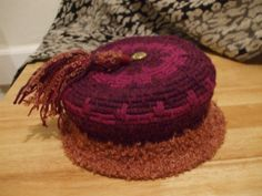 Ladies coiled basketry technique hat with Vintage button on top and yarn tassel. Created by Susan Richardson of Desert Mojo Designs.
