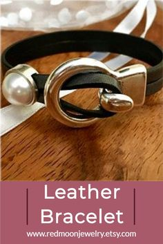 When leather meets pearl, something magic happens! This is a classic leather wrap bracelet for women with faux pearl - but it looks so real. Choose from 8 leather colors to personalize to suit your style. Free shipping from Red Moon Jewelry on Etsy. #leatherandpearls