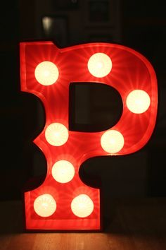 """15"""" high letter """"P"""". Fire Engine Red with 8 White light bulbs."""