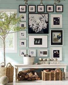 This photo wall is near perfection to me. But I have to work with existing photos and frames in my case. I can use modular arrangement principals from this that appeal to me greatly, though.