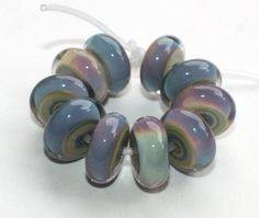 Etsy listing at https://www.etsy.com/listing/466742839/set-of-10-donut-disc-beads-raku-multi