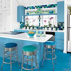 Trade in the usual counter-height seating for diner-style barstools. They're a durable, family-friendly choice that wipes clean easily. Similar to shown: Retro diner barstool, about $78; barstoolsandchairs.com